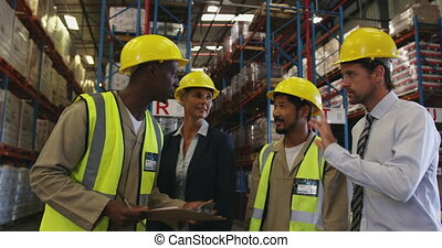 Two managers and two workers meeting in a warehouse 4k - ...