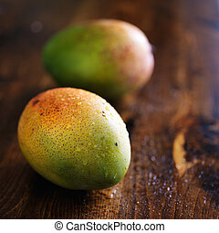 two mangos shot with selective focus