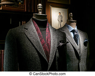 Two Mannequins in Coat and Suit - Two mannequin in a tailor'...