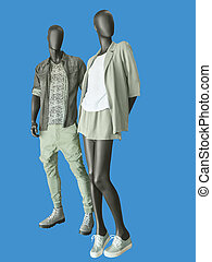Two mannequins, male and female, dressed in casual clothes.