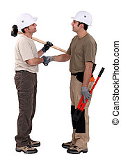 Two manual worker shaking hands.
