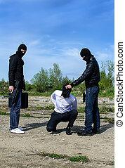 Two masked gunman trying to kill businessman