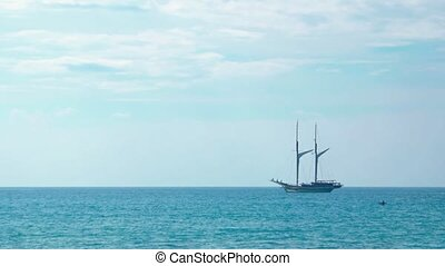 Two Masted Wooden Sailboat, Anchored on the Tropical Horizon. Video UltraHD