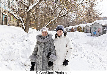 Two mature walking women - Two beautiful mature woman...