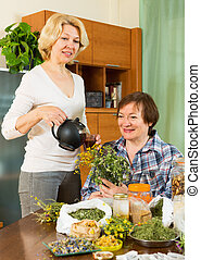 Two mature women with  herbs