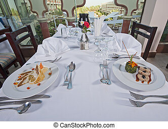 Two meals in an a la carte restaurant - Two meals on table...