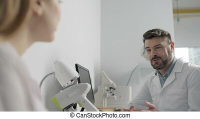 Two medical colleagues having a conversation