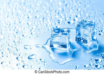 Two melted ice cubes with water drops