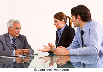 two men and one woman during a job interview