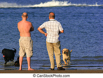 Two Men And Their Dogs