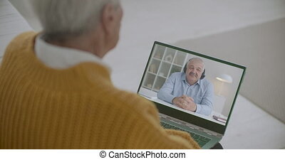 two men are communicating online, friends are chatting by video call, using notebooks with web camera