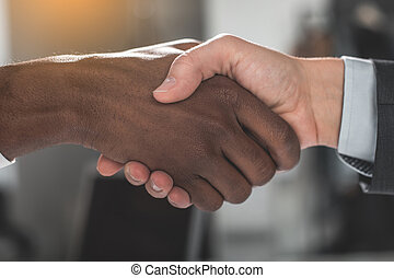 Two men are shaking hands