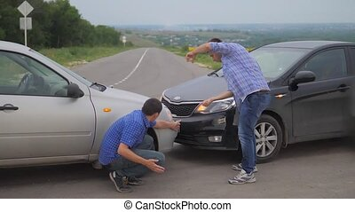 Two men arguing conflict after a car accident on lifestyle...