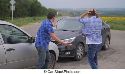 Two men arguing conflict after a car accident on the road...