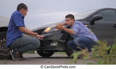 Two men arguing conflict lifestyle after a car accident on...