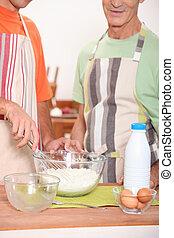 Two men baking