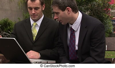 Two Men Businessmen Working as a team