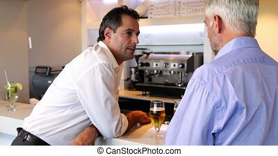 Two men chatting and drinking beer
