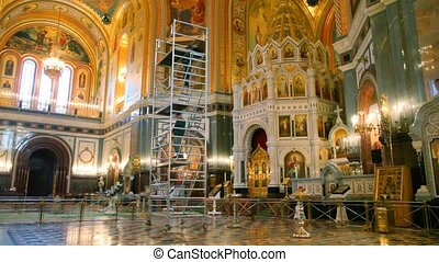 Two men comes down on erecting ladder in cathedral - two men...