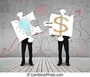 Two men connecting puzzles for idea is money concept on...