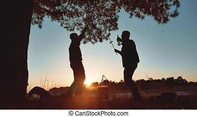 two men dancing at a camping party on nature fun funny...