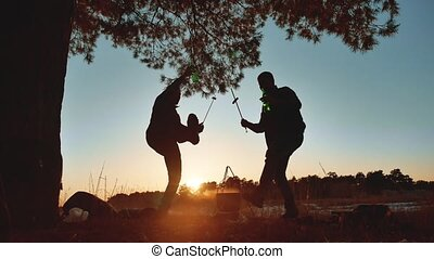two men dancing at camping a party on nature fun funny...
