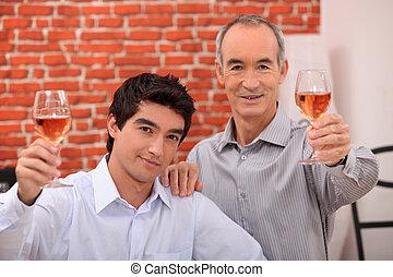 Two men drinking rose