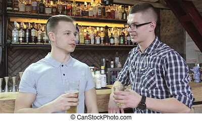 Two men drinks at the bar
