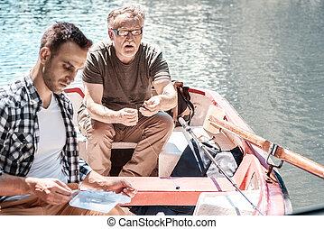 Two men engaged in fishing