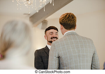 Two Men Exchanging Vows On Their Wedding Day