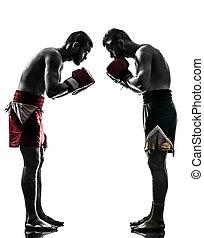 two men exercising thai boxing salute silhouette - two...