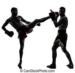 two men exercising thai boxing silhouette