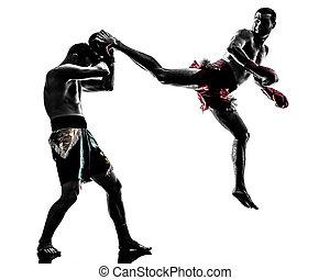 two men exercising thai boxing silhouette - two caucasian...