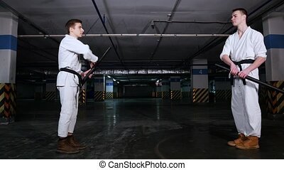 Two men greeting each other before the training sword fight....