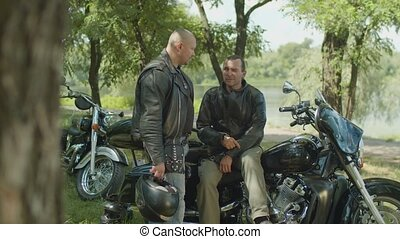 Two men having a break after motorbike ride - Serious moto...