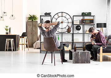 Two men in apartment