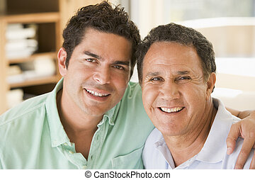 Two men in living room smiling