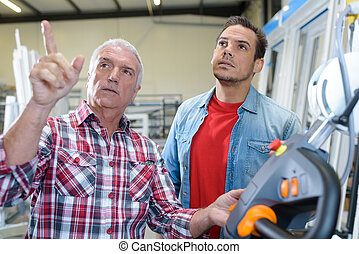 two men in window manufacturing factory
