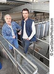Two men in wine factory