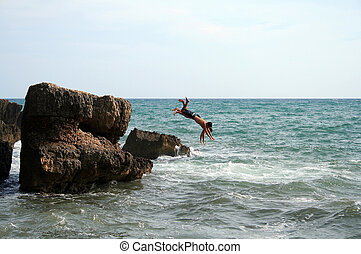 two men jumping into the water