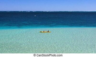 Two men kayaking on Monkey Mia - Long shot of men kayaking...