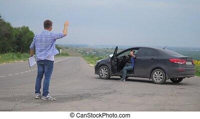 two men make a deal. lifestyle man seller driver makes car...