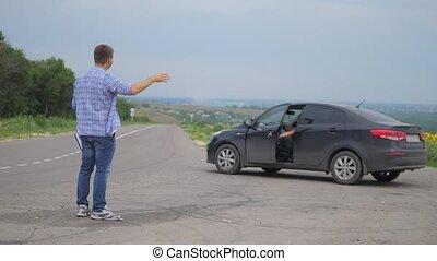 two men make a deal lifestyle. man seller driver makes car...