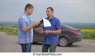 two men make a deal. man seller driver makes car the auto...