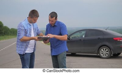 two men make a deal. man seller driver makes car the auto...