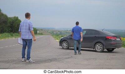 two men make a deal. man seller driver makes lifestyle car...