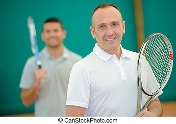Two men on tennis court