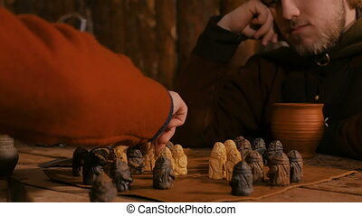 Two men playing popular strategy board game - tafl - Close...
