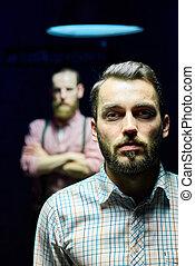 Two Men Posing in Dark
