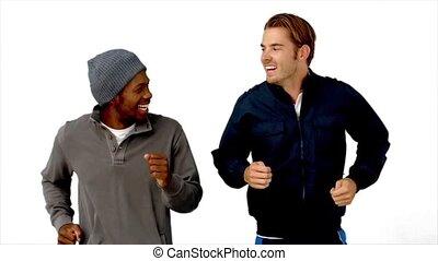 Two men running on white background